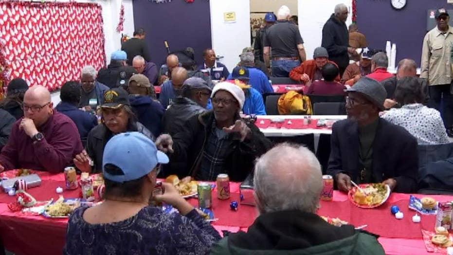 Veterans get a hot holiday meal courtesy of Oakland Raiders defensive lineman Jonathan Hankins