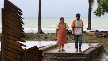 Indonesian officials raise threat level as volcano threatens to trigger second tsunami