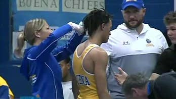 New Jersey referee who ordered wrestler to cut dreadlocks suspended for 2 years