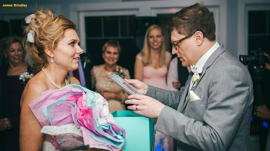 bride announces pregnancy at wedding reception surprises groom with