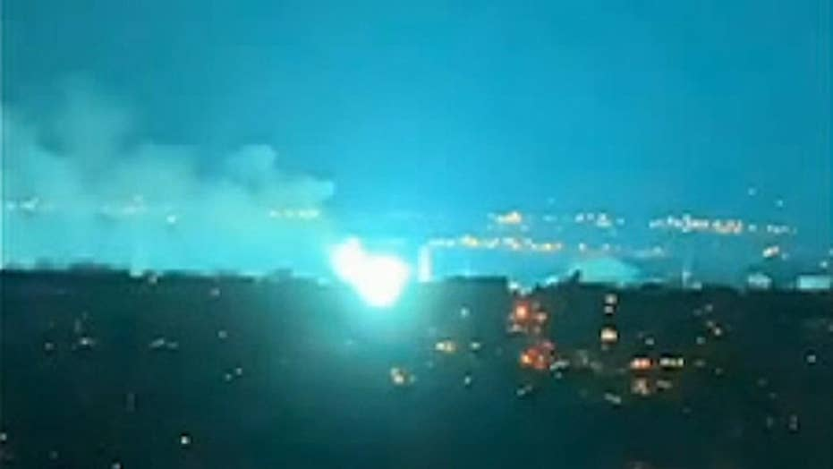 Transformer fire at Con Edison facility turns night sky over New York City an eerie blue-green