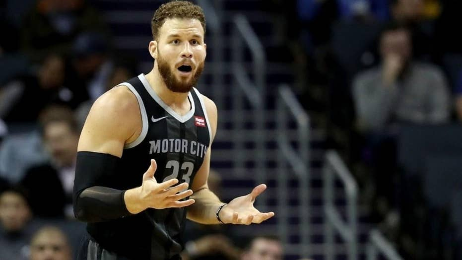 NBA star Blake Griffin uses tablet to argue call with referee