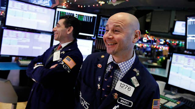 What do wild swings on Wall Street indicate about the economic outlook for 2019?