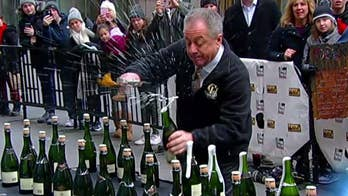 Bottle popper! Butch Yamali looks to break the world champagne sabering record of 66 bottles in 60 seconds