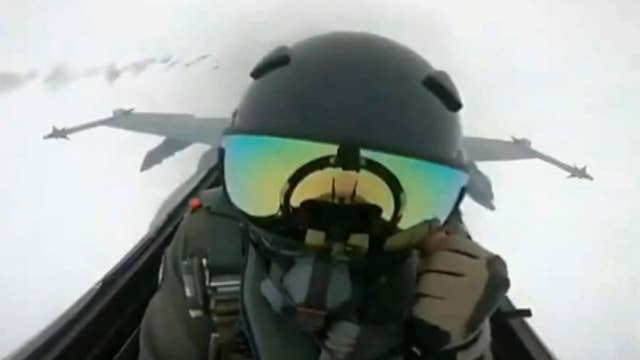 Watch as a bolt of lightning strikes the cockpit of FA-18 fighter jet