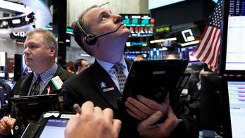 Wild swings on Wall Street: What does the stock market's volatility in 2018 mean for investors in the new year?