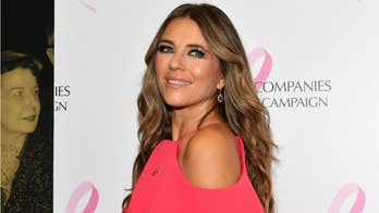 Elizabeth Hurley, 53, shows off flat tummy in striped bikini