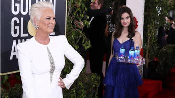 Golden Globes Fiji Water model is suing the brand