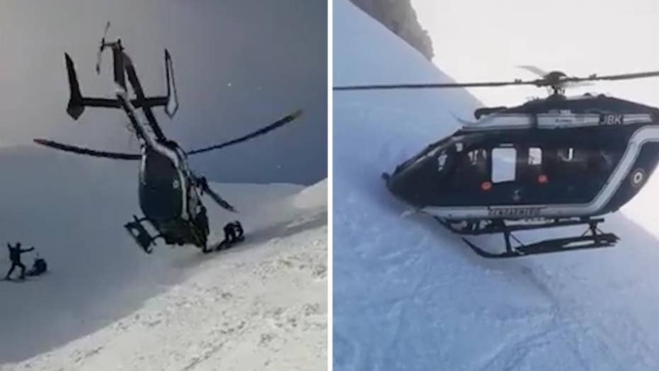 Helicopter pilot displays impressive skills in rescue of injured skier on French mountainside