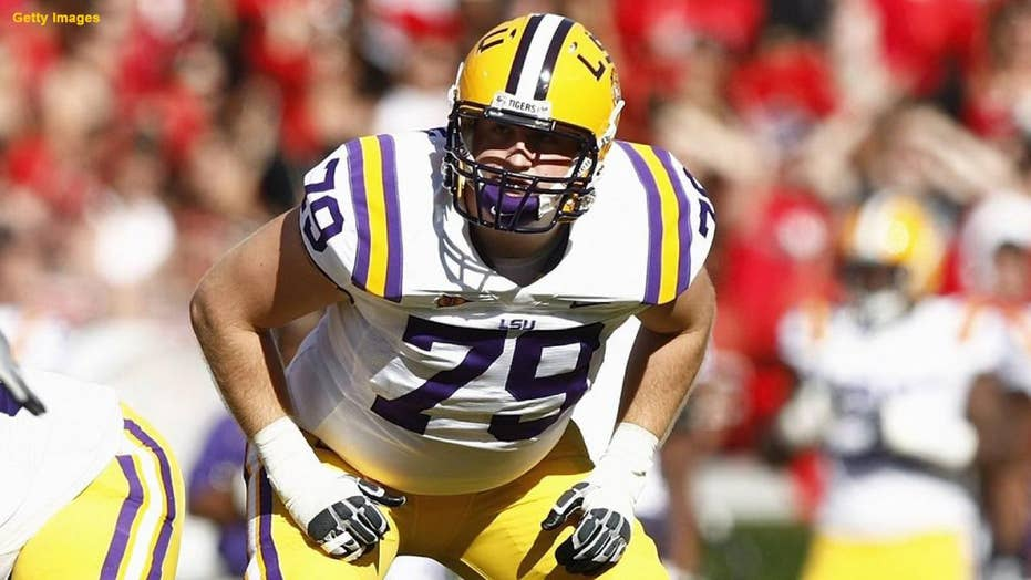 Former Louisiana State University lineman was shot by his dog while duck hunting
