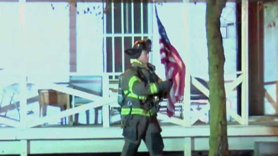 Firefighter, navy veteran saves home owner's American flag from burning Ohio home moments before the house collapses