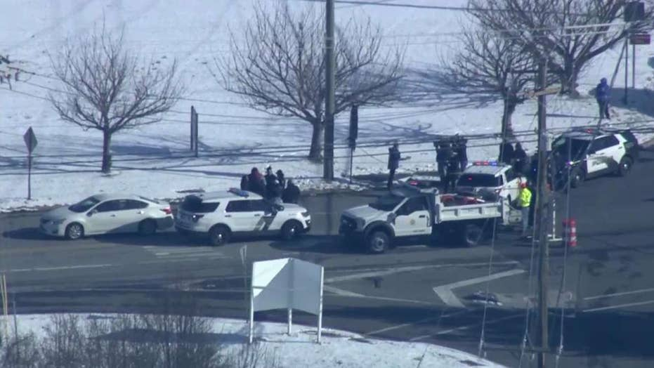 Police respond to hostage situation at UPS facility in Logan Township, New Jersey following reports of active shooter