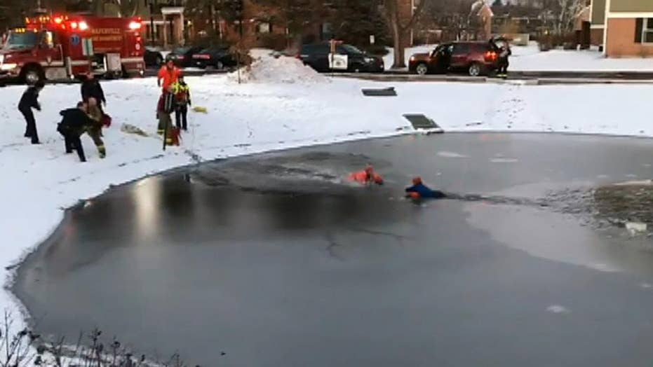 Firefighters, police rescue child who fell through ice on frozen pond
