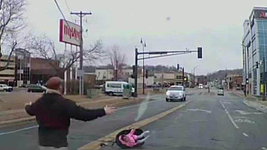 Toddler flies out of moving car while still strapped to car seat