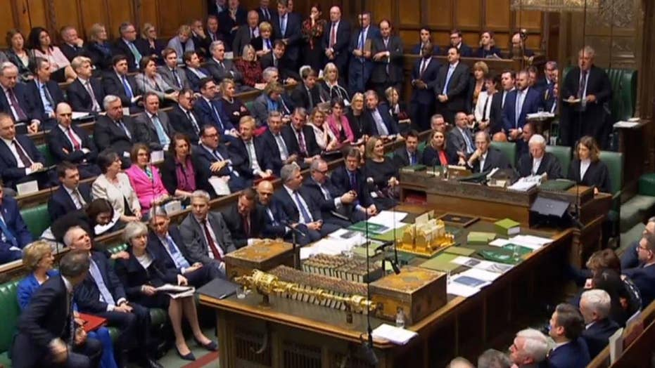 British lawmakers vote overwhelmingly to reject Prime Minister Theresa May's Brexit plan
