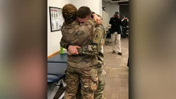 Army couple's surprise reunion caught on camera
