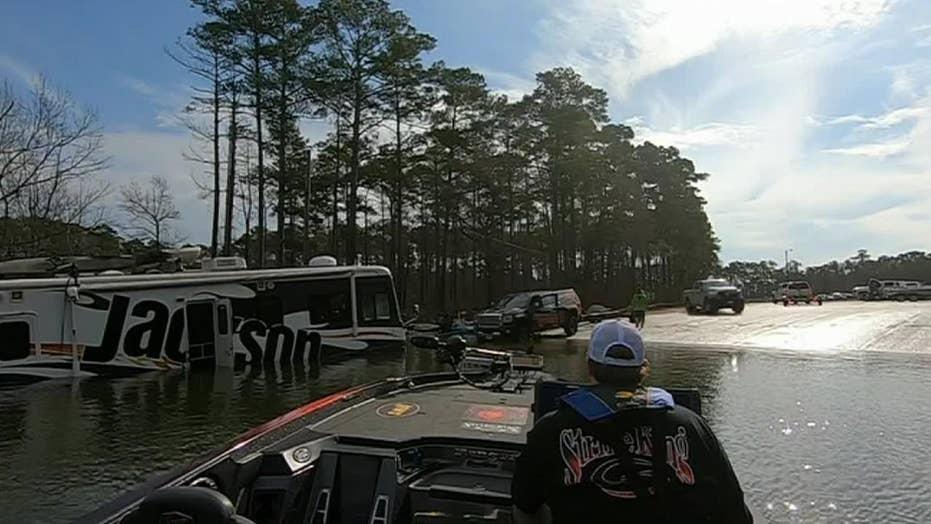 Fisherman's dog sends 38-foot RV flying into lake