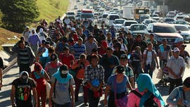 Nearly 1,000 caravan migrants start process of entering Mexico from Guatemala