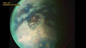 Rain spotted on Saturn's moon Titan, which may be home to alien life