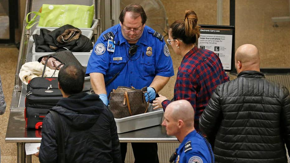 TSA employees continue to work without pay amid partial government shutdown