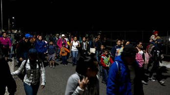 Honduran migrant caravan crosses into Mexico through open border checkpoint