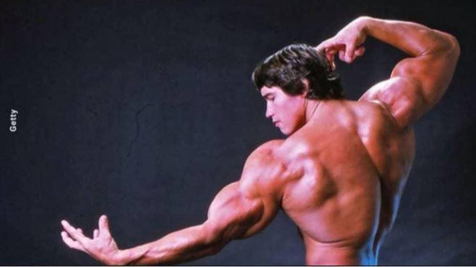 Arnold Schwarzenegger's son recreates his father's iconic bodybuilding pose