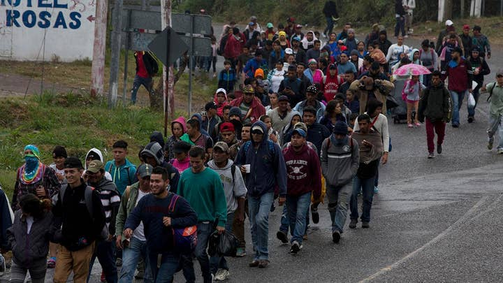 Migrant caravan from Honduras crosses into Mexico after gates were left open