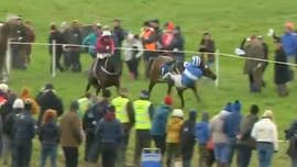 Irish jockey makes incredible recovery and wins race after nearly falling off his horse, video shows