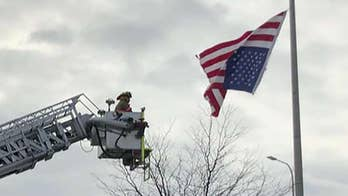 Missouri police officer enlists fire department to fix American flag hanging upside-down