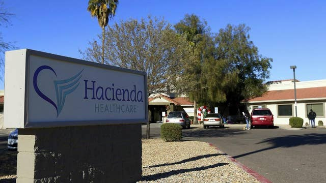 Two doctors leave the Hacienda HealthCare facility where a patient in a vegetative state gave birth