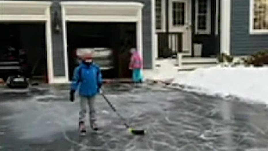 Kids make the most of the winter storm that turned their driveway into an ice rink