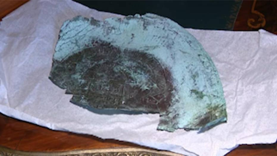A mask fragment containing rare space metal washes ashore on a Florida beach