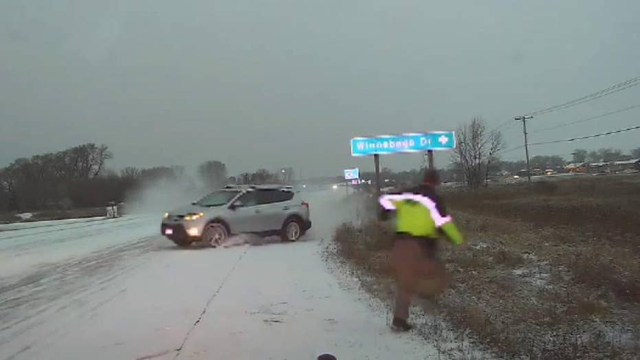 Deputy narrowly escapes oncoming vehicle during Wisconsin snowstorm