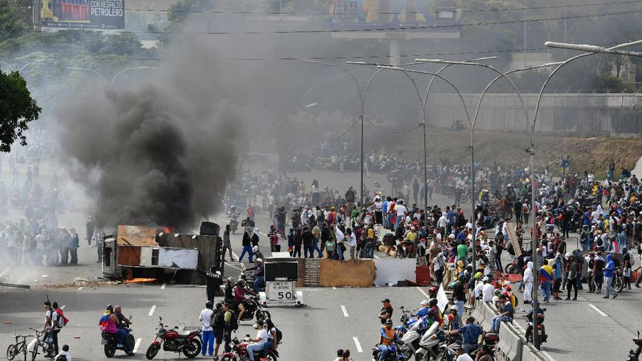 U.S.-backed Venezuelan opposition leader declares himself interim president in effort to oust Maduro