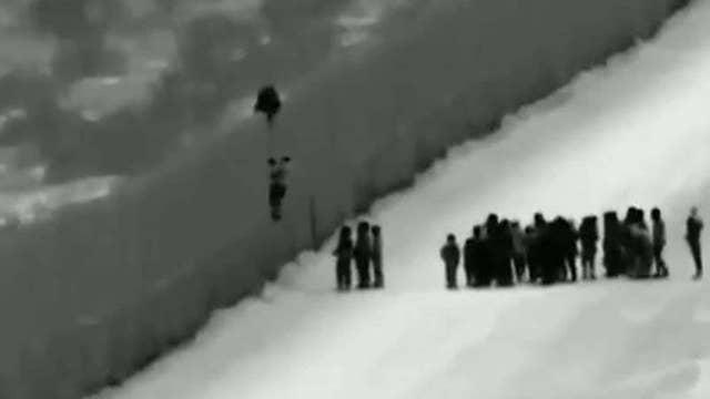 Migrants seen climbing over border wall in Arizona