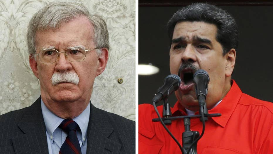 Bolton warns Venezuela's Maduro to stay away from Americans as crisis deepens