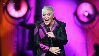 Pink defends her two children over photo of them running at a Holocaust memorial