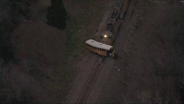 Freight train slams into school bus killing student and injuring others