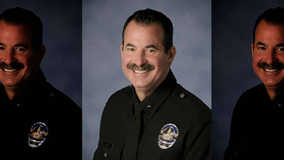 LAPD commander abandons cop car after wreck