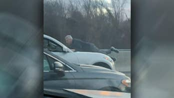 Massachusetts man, 65, clings to hood of SUV on turnpike in suspected road-rage incident