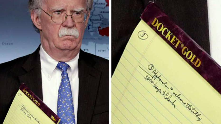 Pressuring Maduro: Notes on John Bolton's legal pad hint at troop deployment