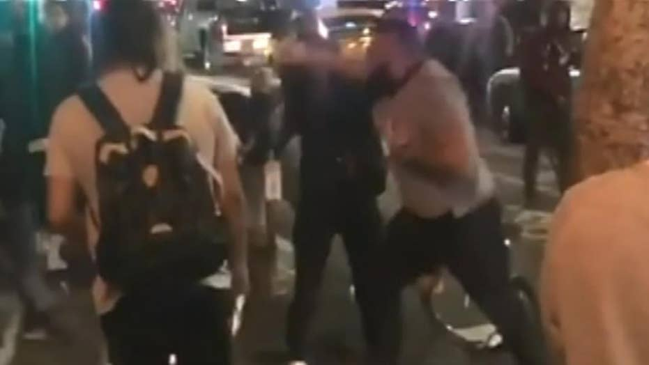 Man brutally punches two women at hot dog stand