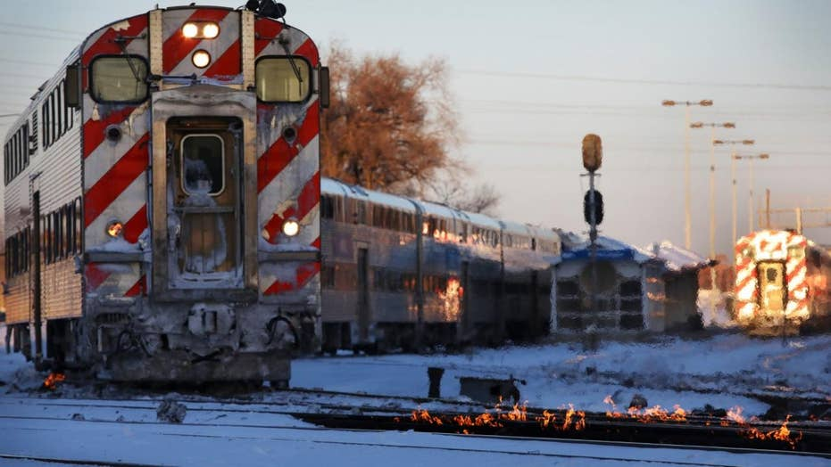 Polar vortex forces Chicago rail crews to use fire to keep trains moving