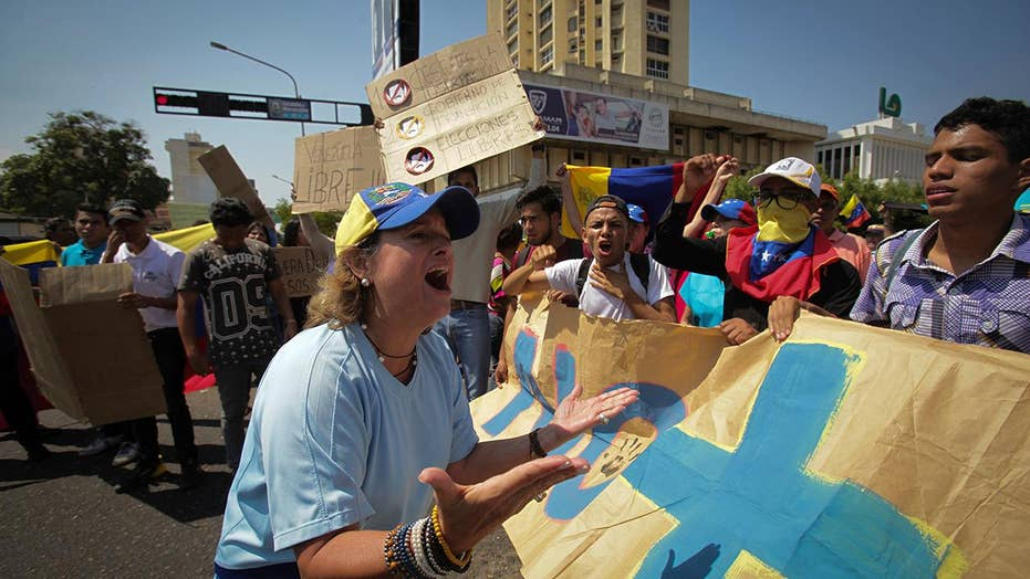 Demonstrators in Venezuela take to the streets to show support for opposition leader Guaido.
