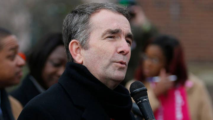 Virginia Governor Ralph Northam faces questions about racist yearbook photo