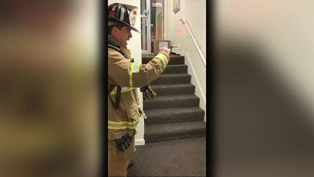 New Hampshire firefighter uses sign language with young boy