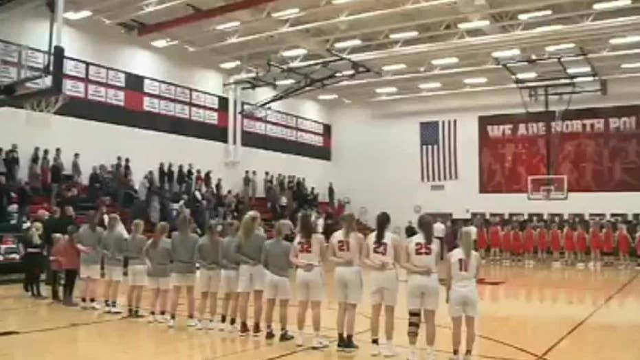 Iowa crowd sings national anthem at high school basketball game