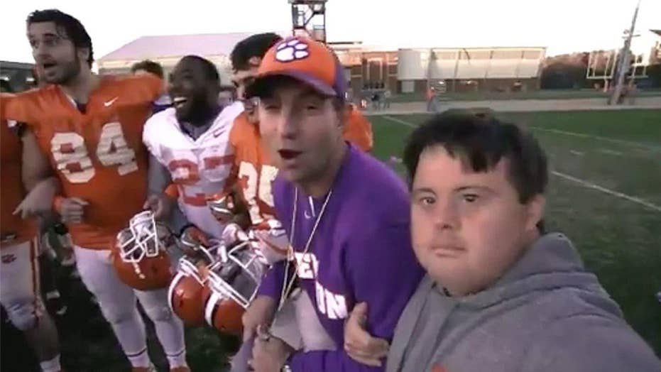 Clemson's Dabo Swinney gifts Super Bowl tickets to team member with Down Syndrome