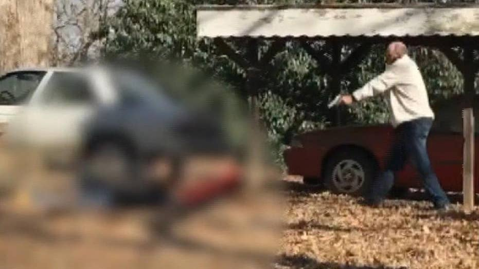 North Carolina man holds robbery suspects at gunpoint after they allegedly broke into his parents' house