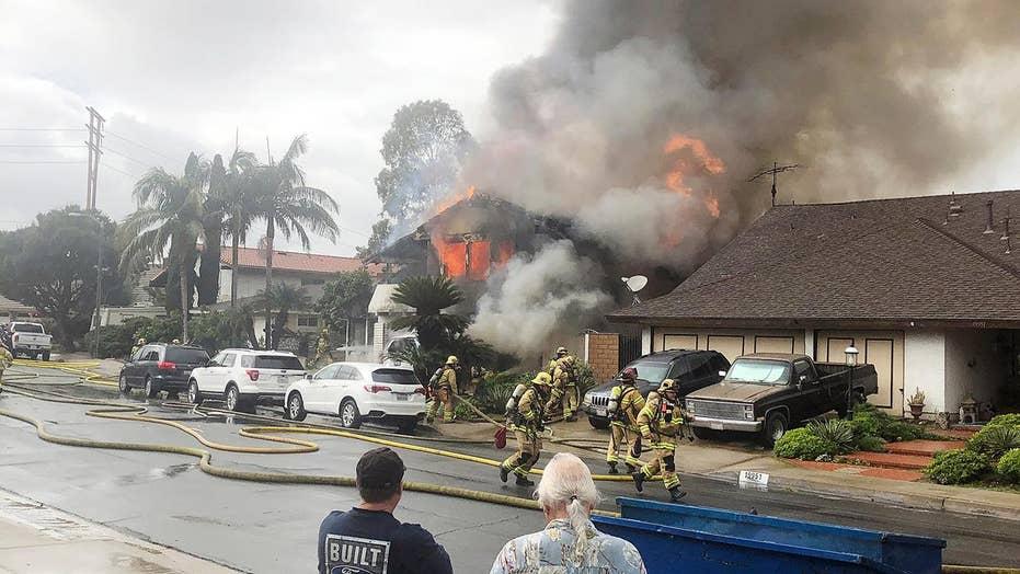Dash cam video shows moment plane bursts into flames before crashing into home